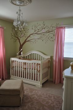 Theresa can totally paint the tree on the wall.  The wall color is Martinique Dawn from Valspar, pink window panels are from Bed, Bath and Beyond, and the chandelier is from Home Depot.  tree wall decal is handmade from etsy