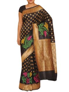Details: Beautiful black pure benarasi silk with booties in zari allover, multicolor floral border and heavy zari pallu Specification: Length: 5.5 meters Width: 1.1 meter Blouse Piece: Yes, 80-90 cms