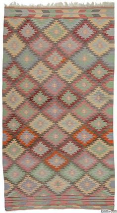 Vintage kilim rug hand-woven in Afyon, located inland from the Aegean coast of Turkey in mid 20th century. This tribal kilim is in very good condition.