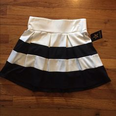 Black and white striped mini skirt a-line Black and white striped A-line mini. Never worn. Bought at a sample sale. Too short /small for me for work Living Doll Skirts Mini