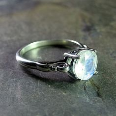 Ice Dance - Rainbow moonstone solitaire ring set in solid sterling silver    ....from LavenderCottage on Etsy