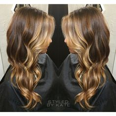 Golden blonde balayage highlights over a rich medium brown base.