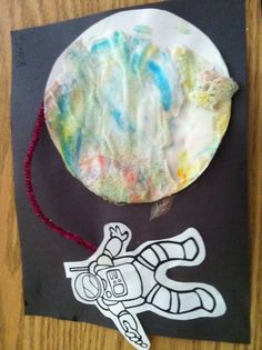 Space craft. Shaving cream, mixed with food coloring dipped,  paper circle and glued on paper with astronaut and pipe cleaner.