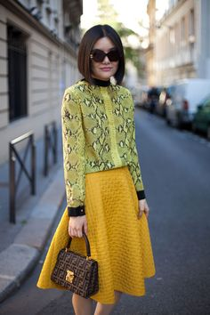 STREET STYLE SPRING 2013: PARIS FASHION WEEK - Two shades of yellow come together in snakeskin and quilting.