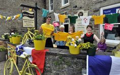 Bunting and knitted jerseys are displayed in Leyburn which is on the Tour de France stage one route