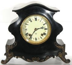 I have a beautiful mantle so I want an antique mantel clock with my modern vases.