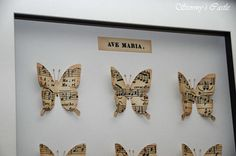"""Butterfly shadow box I created using a vintage sheet of """"Ave Maria"""" music."""