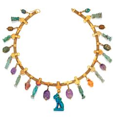 Egyptian-Revival Gold, Colored Stone, Faience and Steatite Necklace, Jules Wièse The gold mesh necklace applied with plaques of stylized Egyptian motifs suspending 23 ancient Egyptian pendants, Middle Kingdom/Late Period, circa 1900-100 B.C., of amethyst, carnelian, faience and steatite in the form of Egyptian gods Babi, Bastet, Bes, Isis and Horus, Nephthys, Theoris and Thoth, with heart amulets, beetle scarabs and scaraboids, length 17 inches, with French assay and maker's marks; circa…
