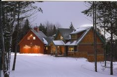 Wait Santa - changed my mind...Exterior photo of a red oak Woodhouse timber frame home in snow