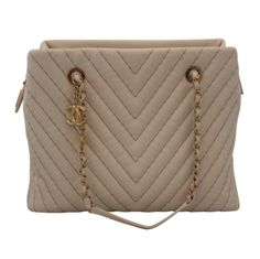 Chanel Bone Chevron Tote - GHW | From a collection of rare vintage handbags and purses at http://www.1stdibs.com/fashion/accessories/handbags-purses/