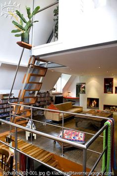Up on the mezzanine - This is so cool for a book case!
