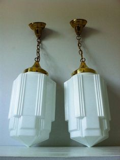Art Deco Skyscraper milk glass light fixtures. We have one of these already in the kitchen hanging over the back entry door.: