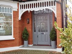Art Deco style front door with a distinctively colourful stained glass design that typified the style of the period – completed with brass door furniture Front Door Steps, Grey Front Doors, Front Door Porch, Porch Steps, Glass Front Door, House Front, Porch Roof, Victorian Front Doors, Victorian Porch