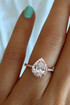 18 Stunning Pear Shaped Engagement Rings ❤️ pear shaped engagement rings in rose gold with halo ❤️ More on the blog: https://ohsoperfectproposal.com/pear-shaped-engagement-rings/ #beautifulweddingringsjewelry