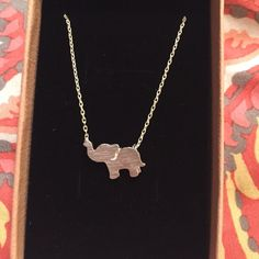 Elephant necklace Sterling silver tiny elephant charm necklace Jewelry Necklaces Elephant Jewelry, Elephant Necklace, Elephants, I Am Awesome, Jewelry Necklaces, Buy And Sell, Ivory, Bling, Fancy