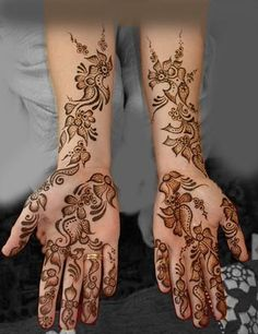 Not sure if this is henna or permanent but its gorgeous....Id like less on the finger- maybe just trickling up the base of the palm (I wouldnt get this one but its beautiful)