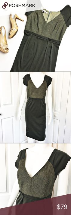 """Diane von Furstenburg Wool Sheath Dress This dress is a timeless classic and perfect for work or a special occasion.  Dress has a v-cut neckline, cap sleeves and back zip with eye hook close.  Dress is in excellent condition and does have stretch.  Material tag has been listed.   Measurements laid flat: Bust:  17"""" Waist:  14"""" Hip:  17"""" Length from top of shoulder to hem:  39.5"""" *Measurements are approximate. Diane Von Furstenberg Dresses"""
