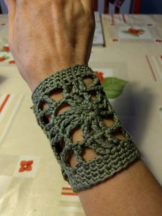 Crochet wristband/bracelet. Closed at the  inside with mother of pearl bottons.