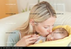 http://www.photaki.com/picture-mother-on-the-sofa-kissing-her-baby_890106.htm