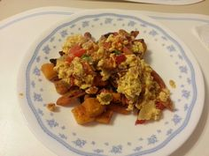 Scrambled eggbeaters with red & green peppers,  & onions over roasted sweet potatoes & carrots, delicious dinner!