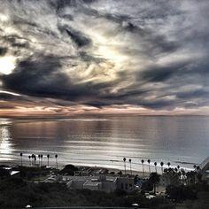 Calm ocean, Van Gogh clouds.
