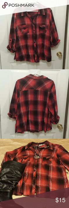 Red, black, and silver plaid button up. Red, black, and silver plaid button up. It is long sleeves but I have them rolled up in the pictures. It does have tiny belt loops but no belt, would look good with or without one. Cato Woman size 18/20. Shows very slight signs of wash wear still in great condition. Cato Tops Button Down Shirts