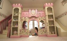 Beautiful indoor playhouse in Eclectic Toronto with Custom Bed next to Princess Castle Loft Bed alongside Bench Storage Seating and Built In Dresser