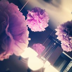 purple bridal shower pom poms - these are cheap and super easy to make