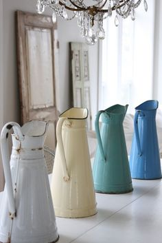 watering pitchers - - - yes this would be neat to line up together on a side table! ~ or on the top of my kitchen shelf, or filled with flowers.