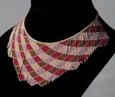 Red pink seed bead necklace, beaded necklace beadwork necklace, handmade original design, brick stitch fringe bib necklace, 15/0 seed beads. $220.00, via Etsy.
