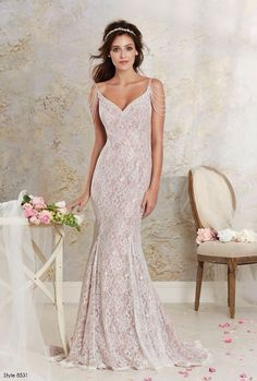 Nude and white lace dress with cascading beaded sleeves