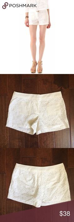 Club Monaco White Shelli Lace Shorts These lace shorts feature patch front pockets and welt back pockets. Double hook-and-eye closure. Shell | 53% Cotton | 47% Nylon | Trim Fabric | 100% Silk | Lining | 100% Polyester | In great condition Club Monaco Shorts