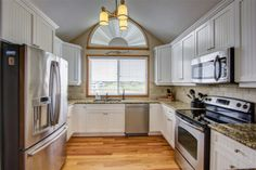 Perfect kitchen remodel at this oceanfront remodel in Southern Shores, NC Bead Board Cabinets, Oak Hardwood Flooring, Subway Tile Backsplash, Custom Kitchens, Parade Of Homes, Build Your Dream Home, Red Oak, Granite Countertops, New Kitchen