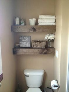 Use same rustic chunky wood for floating counter, storage shelves in bathroom 2 and floating shelves above toilet in both bathroom 1 and bathroom 2.