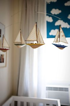 boat mobile for a nautical nursery @Shannon Binekey, these would be easy to make with black boats/white sails!