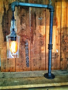My newest creation for sale. This industrial style desk lamp is made from black pipe, reclaimed wood and a Jack Daniels bottle finished with a vintage style Edison radio bulb. $165