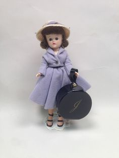 #3181 (1958)  Blue fleece two piece suit with rhinestone button jacket, straw hat.  Came with white pocketbook and shoes and black pocketbook and shoes.  (Shown with Jill's hatbox in picture.)  Collector's Encyclopedia of Vogue Dolls, Second Edition, page 255.