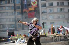 A protestors uses a slingshot against Turkish riot police on Taksim square on June 11, 2013.