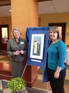 President McNamara and Sister Jenn Shaaf stand next to an easel of St. Catherine of Siena. #Education #DominicanTradition #CatholicCollege #AlbertusMagnusCollege #2014
