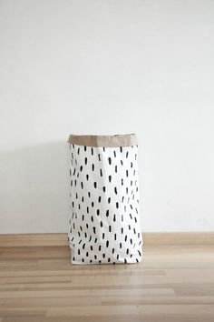 This storage bag is made from two layer paper - outside white and the middle one grey.  It is an eco-friendly reusable bag which can hold up to 10 kilograms.  All our bags are hand...