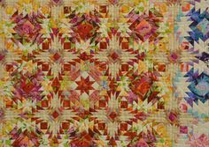 "Detail of ""Start Again"" by Kimie Yanagisawa, shown at the Jan 2011 Tokyo Quilt Festival. Note how she uses large scale fabrics, cutting into small pieces to integrate into the overall patchwork pattern."