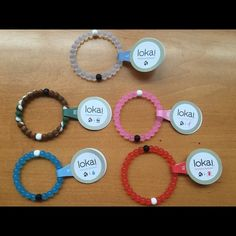 You choose 5 Lokai bracelets Choose any 5 Lokai Bracelets from the colors: red, pink, blue, clear, and camo. Sizes available are: Small, medium, large, XL. Fast shipping! Simply comment which you would like before purchasing. Thanks :) Lokai Jewelry Bracelets