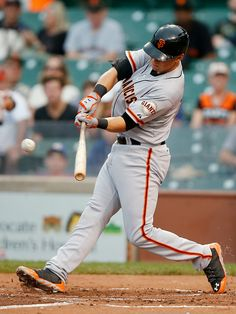 San Francisco Giants' Joe Panik hits an RBI-single against the Chicago Cubs during the sixth inning of thecontinuationof abaseballgame that beganTuesday, on Thursday, Aug. 21, 2014, in Chicago. Tuesday'sgame was suspended in the fifth inning due to rain. (AP Photo/Andrew A. Nelles)