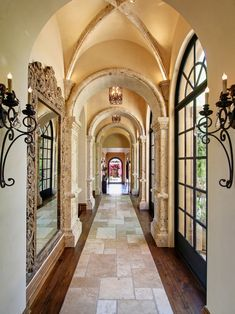 hallway. love the arches, coin celing, french arched windows, mirror, lighting, colors