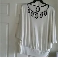 Really cute top Size 3x true to size bat wing, comfortable and in pre loved condition  Tops Blouses