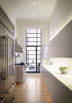 i wouldn't mind a galley kitchen if this was it! neutrals. natural light. stainless steel. hardwood floors.