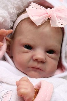 Sally by Bonnie Brown,beautiful reborn baby doll!!!  I love her face.