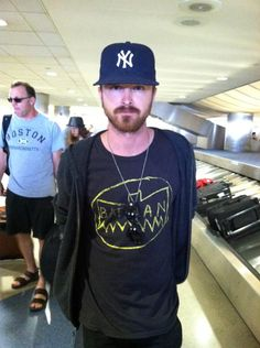 Breaking Bad star Aaron Paul spotted wearing our Junk Food messy Batman logo tee at Lollapalooza this summer!