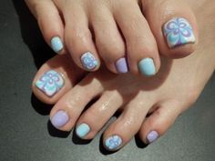 Pretty pedicure: White polish with Light Blue and Lavender design (resembles a butterfly)  Alternating Light Blue and Lavender on the small toes. Great pedicure design for Spring!