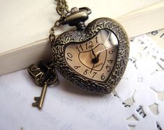 heart-shaped transparent lid pocket watch necklace with a cute treasure chest and key. $6.45, via Etsy.